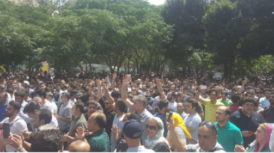 BREAKING: Irate Iranian merchants march on parliament in Tehran to protest at currency's collapse
