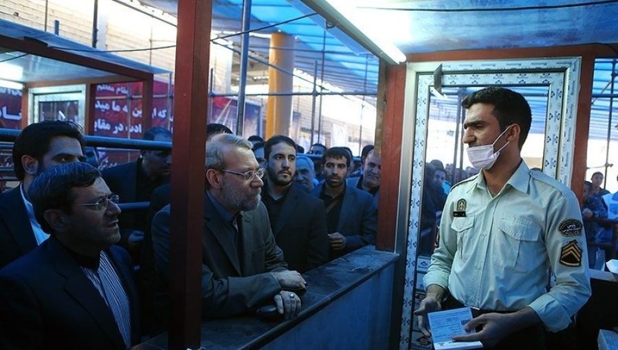 Iraqi central bank bans citizens from taking dollars into Iran Ali_Larijani_in_Iran-Iraq_border_06