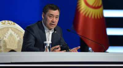 Fears of authoritarianism as Kyrgyz populist wins landslide and backing for 'Khanstitution'