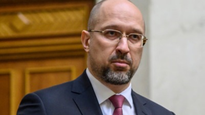 Ukraine's Prime Minister Denys Shmyhal causes a short flurry with gaffe confusing restructuring debt for refinancing
