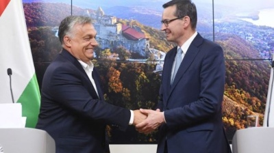 Poland and Hungary block EU budget over rule of law link